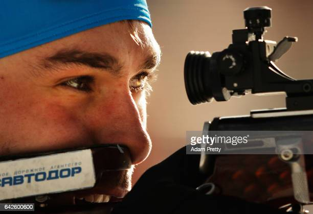 Anton Shipulin of Russia shoots on his way to victory over Martin Fourcade and team France during the Men's 4x 75km relay competition of the IBU...