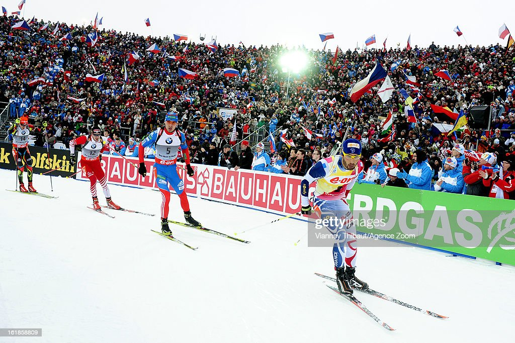 Anton Shipulin of Russia takes 2nd place, Martin Fourcade of France competes during the IBU Biathlon World Championship Men's 15km Mass Start on February 17, 2013 in Nove Mesto, Czech Republic.