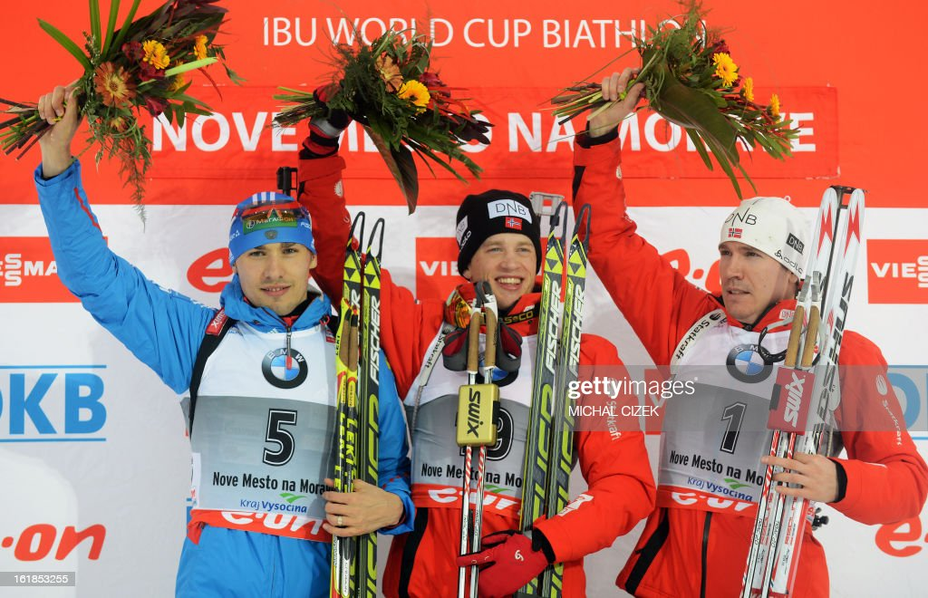 Anton Shipulin of Russia ,Tarjei Boe of Norway and Emil Hegle Svendsen of Norway celebrate at the podium after the 15 km men mass start competition in Biathlon World Championship on February 17, 2013, in Nove Mesto na Morave, Czech Republic. Boe won this competition ahead of Anton Shipulin of Russia and Emil Helge Svendsen of Norway.