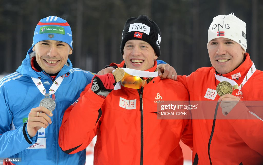 Anton Shipulin of Russia,Tarjei Boe of Norway and Emil Hegle Svendsen of Norway pose with their medals after the men's 15 km mass start as part of the IBU Biathlon World Championships in Nove Mesto, Czech Republic, on February 17, 2013. Tarjei Boe of Norway won the race ahead of Anton Shipulin of Russia and Emil Hegle Svendsen of Norway. AFP PHOTO / MICHAL CIZEK