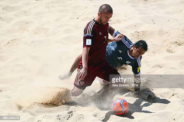 Anton Shkarin of Russia is challenged by Pedro Moran of Paraguay during the FIFA Beach Soccer World Cup Portugal 2015 Group D match between Russia...