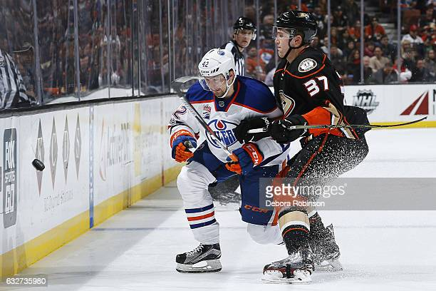 Anton Slepyshev of the Edmonton Oilers battles for the puck against Nick Ritchie of the Anaheim Ducks during the game on January 25 2017 at Honda...
