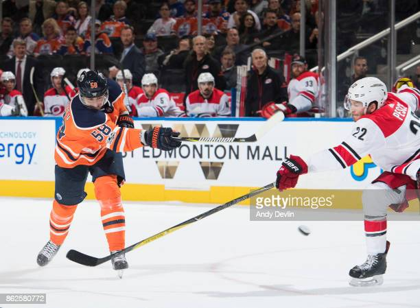 Anton Slepyshev of the Edmonton Oilers shoots the puck past Brett Pesce of the Carolina Hurricanes on October 17 2017 at Rogers Place in Edmonton...