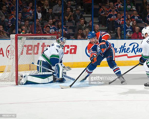 Anton Slepyshev of the Edmonton Oilers takes a shot on Jacob Markstrom of the Vancouver Canucks on October 1 2015 at Rexall Place in Edmonton Alberta...