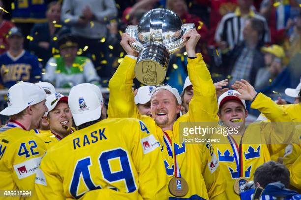 Anton Stralman celebrates with the trophy during the Ice Hockey World Championship Gold medal game between Canada and Sweden at Lanxess Arena in...