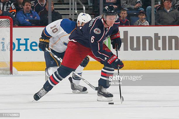 Anton Stralman of the Columbus Blue Jackets skates the puck up ice away from Andy McDonald of the St Louis Blues on April 3 2011 at Nationwide Arena...