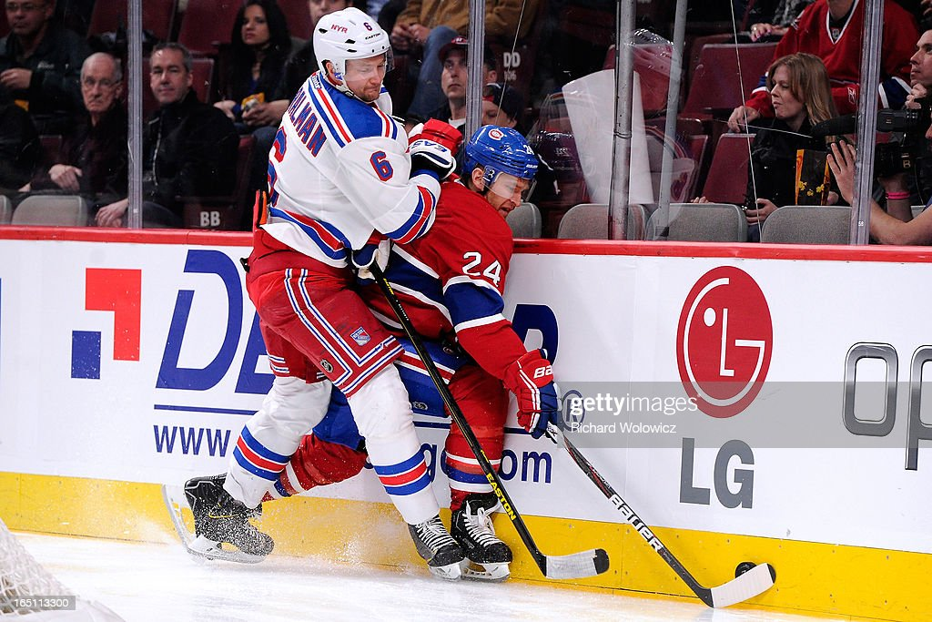 Anton Stralman #6 of the New York Rangers and Jeff Halpern #24 of the Montreal Canadiens battle for the puck during the NHL game at the Bell Centre on March 30, 2013 in Montreal, Quebec, Canada.