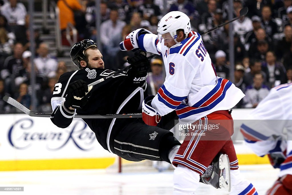 <a gi-track='captionPersonalityLinkClicked' href=/galleries/search?phrase=Anton+Stralman&family=editorial&specificpeople=2271901 ng-click='$event.stopPropagation()'>Anton Stralman</a> #6 of the New York Rangers checks <a gi-track='captionPersonalityLinkClicked' href=/galleries/search?phrase=Kyle+Clifford&family=editorial&specificpeople=4640225 ng-click='$event.stopPropagation()'>Kyle Clifford</a> #13 of the Los Angeles Kings in the second period during Game One of the 2014 NHL Stanley Cup Final at the Staples Center on June 4, 2014 in Los Angeles, California.