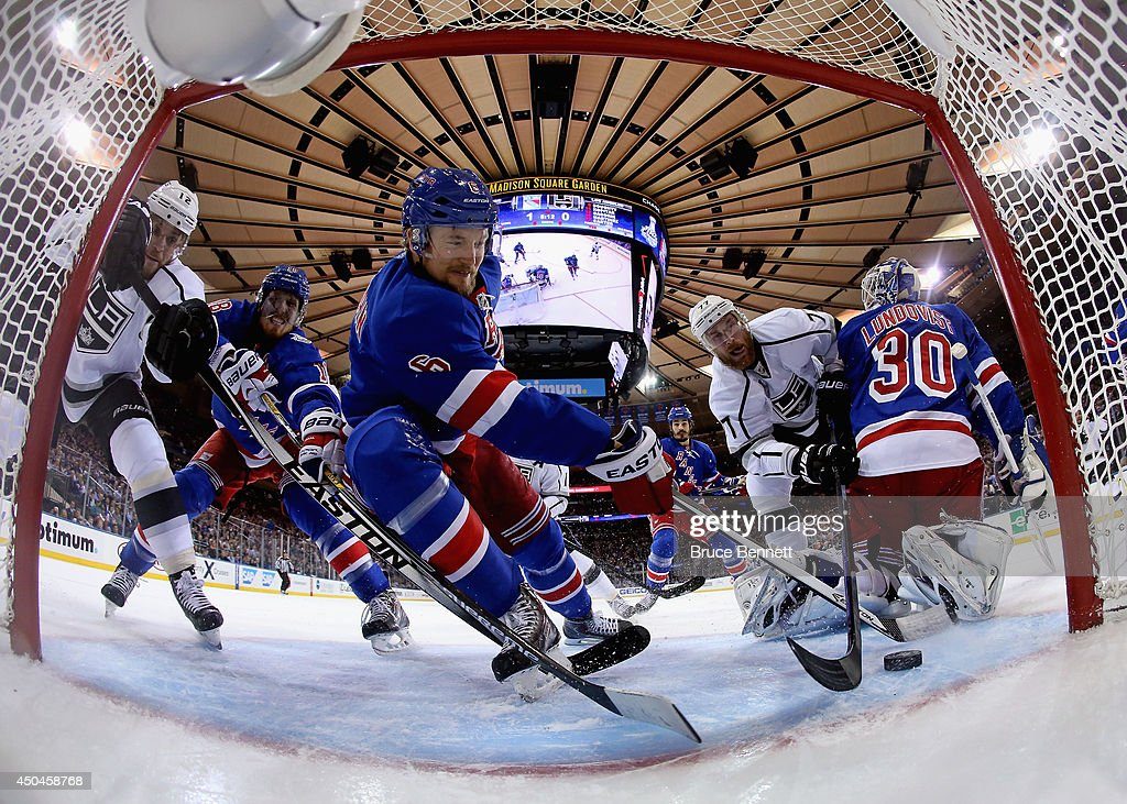 Anton Stralman #6 of the New York Rangers defends the puck from Jeff Carter #77 of the Los Angeles Kings during the first period of Game Four of the 2014 NHL Stanley Cup Final at Madison Square Garden on June 11, 2014 in New York, New York.