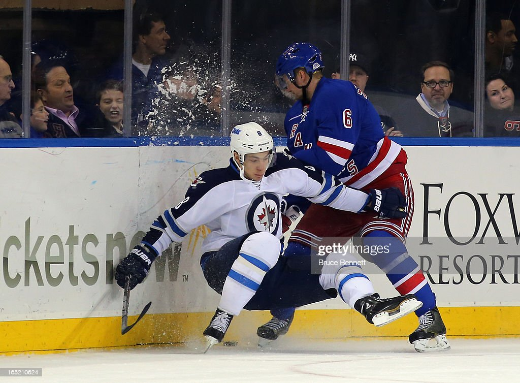 <a gi-track='captionPersonalityLinkClicked' href=/galleries/search?phrase=Anton+Stralman&family=editorial&specificpeople=2271901 ng-click='$event.stopPropagation()'>Anton Stralman</a> #6 of the New York Rangers dumps Alex Burmistrov #8 of the Winnipeg Jets at Madison Square Garden on April 1, 2013 in New York City. The Rangers defeated the Jets 4-2.