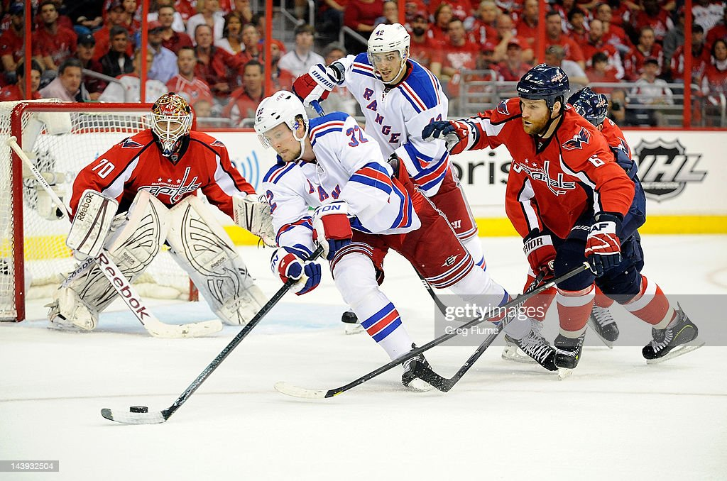 Anton Stralman of the New York Rangers handles the puck against Dennis Wideman of the Washington Capitals in Game Four of the Eastern Conference...