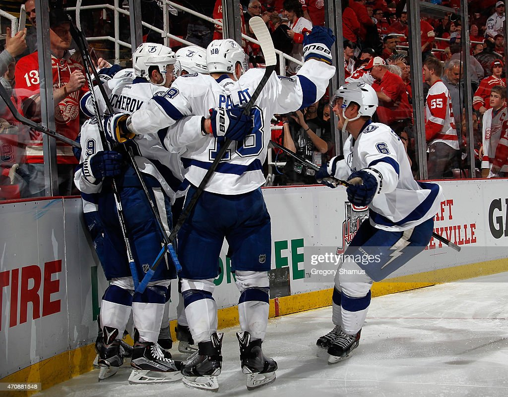 <a gi-track='captionPersonalityLinkClicked' href=/galleries/search?phrase=Anton+Stralman&family=editorial&specificpeople=2271901 ng-click='$event.stopPropagation()'>Anton Stralman</a> #6 of the Tampa Bay Lightning celebrates with teammates after a game winning overtime goal by <a gi-track='captionPersonalityLinkClicked' href=/galleries/search?phrase=Tyler+Johnson+-+Ice+Hockey+Player&family=editorial&specificpeople=14574766 ng-click='$event.stopPropagation()'>Tyler Johnson</a> #9 to beat the Detroit Red Wings 3-2 in Game Four of the Eastern Conference Quarterfinals during the 2015 NHL Stanley Cup Playoffs at Joe Louis Arena on April 23, 2015 in Detroit, Michigan.