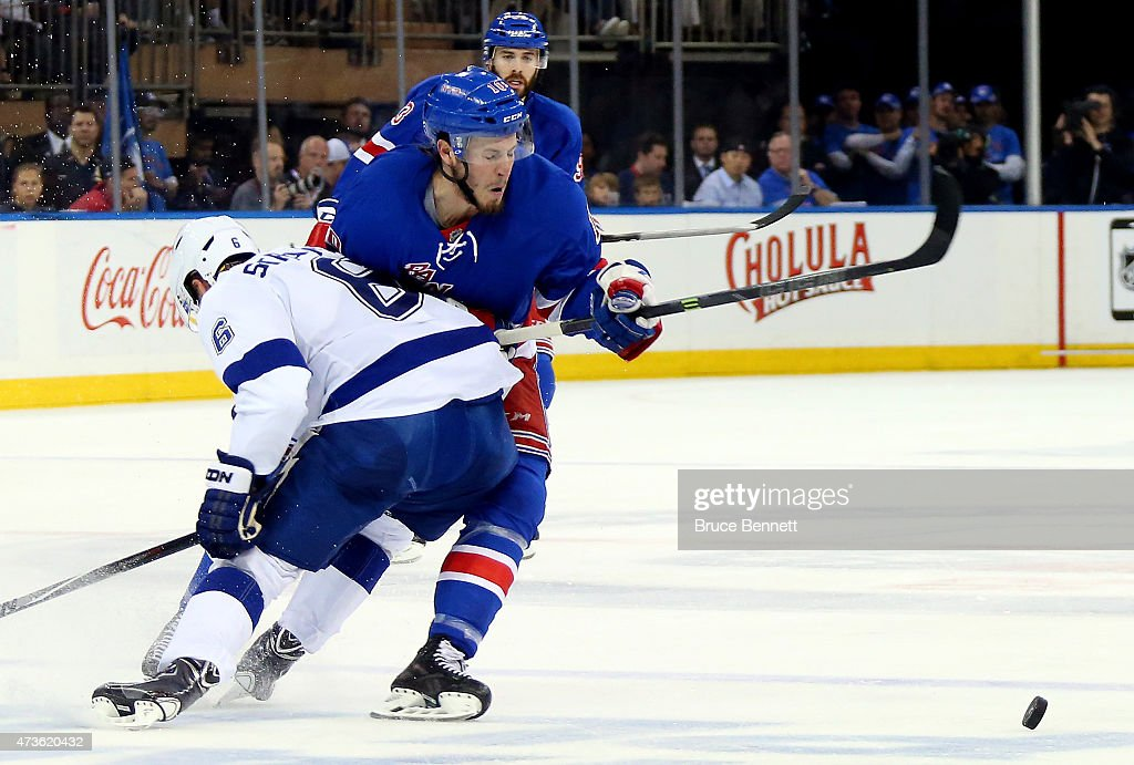 <a gi-track='captionPersonalityLinkClicked' href=/galleries/search?phrase=Anton+Stralman&family=editorial&specificpeople=2271901 ng-click='$event.stopPropagation()'>Anton Stralman</a> #6 of the Tampa Bay Lightning checks <a gi-track='captionPersonalityLinkClicked' href=/galleries/search?phrase=J.T.+Miller&family=editorial&specificpeople=4663469 ng-click='$event.stopPropagation()'>J.T. Miller</a> #10 of the New York Rangers in the second period of Game One of the Eastern Conference Finals during the 2015 NHL Stanley Cup Playoffs at Madison Square Garden on May 16, 2015 in New York City.