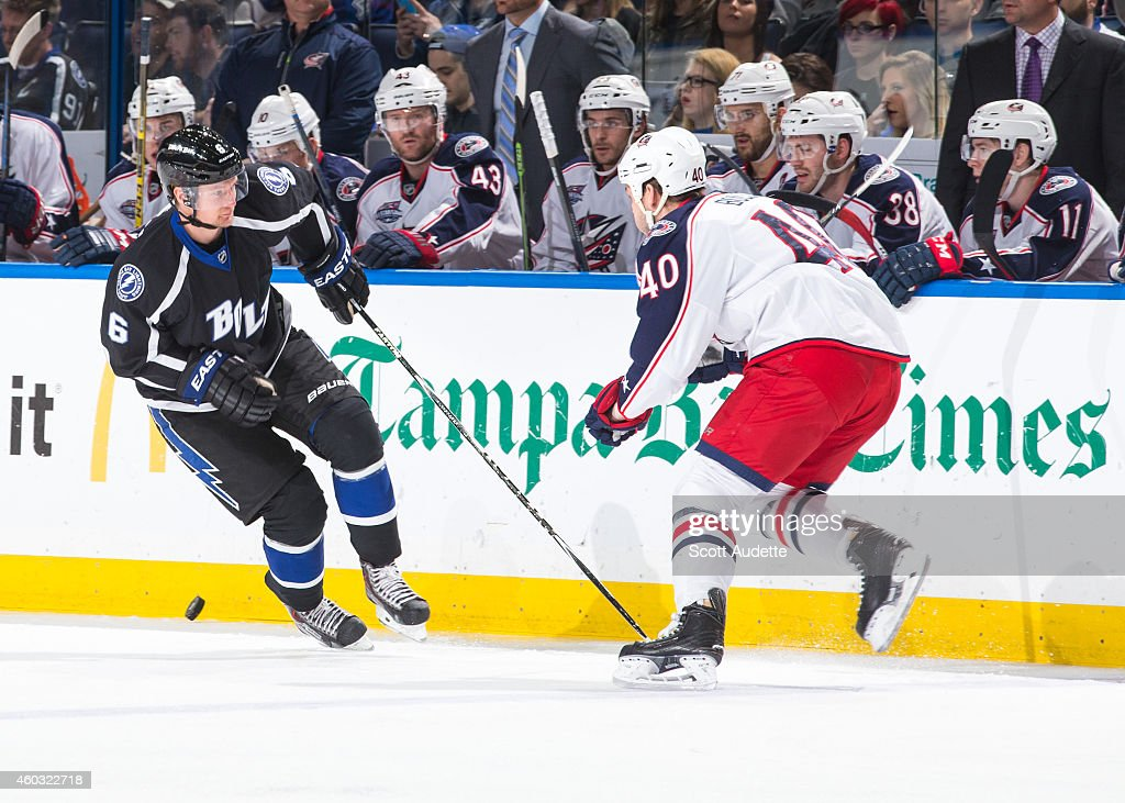 Anton Stralman of the Tampa Bay Lightning skates against Jared Boll of the Columbus Blue Jackets during the first period at the Amalie Arena on...