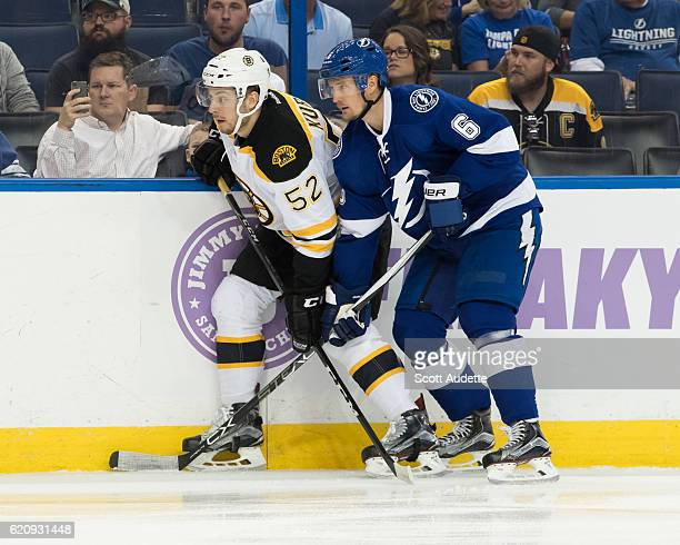 Anton Stralman of the Tampa Bay Lightning skates against Sean Kuraly of the Boston Bruins during the first period at Amalie Arena on November 3 2016...