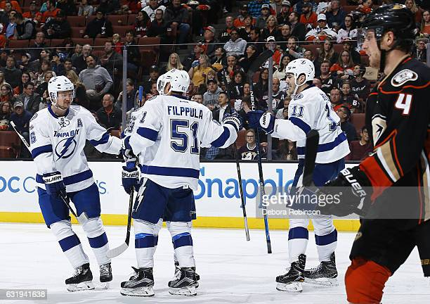 Anton Stralman Valtteri Filppula and Brian Boyle of the Tampa Bay Lightning celebrate Filppula's second period goal against Cam Fowler of the Anaheim...