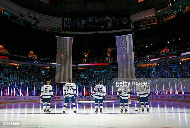 Anton Stralman Victor Hedman Nikita Kucherov Tyler Johnson and Alex Killorn of the Tampa Bay Lightning listen to the national anthems during their...