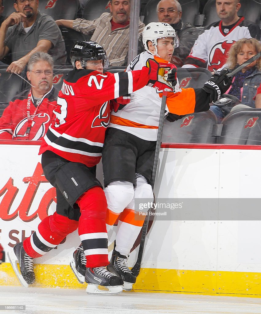 Anton Volchenkov #28 of the New Jersey Devils checks Matt Read #24 of the Philadelphia Flyers during the third period of an NHL hockey game at Prudential Center on November 2, 2013 in Newark, New Jersey.