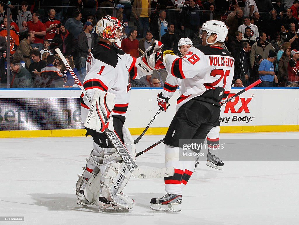 <a gi-track='captionPersonalityLinkClicked' href=/galleries/search?phrase=Anton+Volchenkov&family=editorial&specificpeople=210890 ng-click='$event.stopPropagation()'>Anton Volchenkov</a> #28 of the New Jersey Devils congratulates Goaltender <a gi-track='captionPersonalityLinkClicked' href=/galleries/search?phrase=Johan+Hedberg&family=editorial&specificpeople=202078 ng-click='$event.stopPropagation()'>Johan Hedberg</a> #1 after defeating the New York Islanders at Nassau Veterans Memorial Coliseum on March 10, 2012 in Uniondale, New York. The Devils defeat the Islanders 2-1.