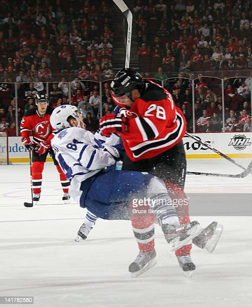 Anton Volchenkov of the New Jersey Devils hits Mikhail Grabovski of the Toronto Maple Leafs at the Prudential Center on March 23 2012 in Newark New...