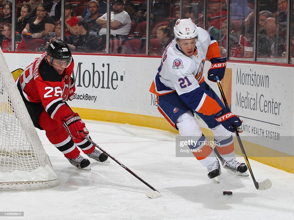 <a gi-track='captionPersonalityLinkClicked' href=/galleries/search?phrase=Anton+Volchenkov&family=editorial&specificpeople=210890 ng-click='$event.stopPropagation()'>Anton Volchenkov</a> #28 of the New Jersey Devils pursues <a gi-track='captionPersonalityLinkClicked' href=/galleries/search?phrase=Kyle+Okposo&family=editorial&specificpeople=540469 ng-click='$event.stopPropagation()'>Kyle Okposo</a> #21 of the New York Islanders as he plays the puck during the game at the Prudential Center on March 8, 2012 in Newark, New Jersey.