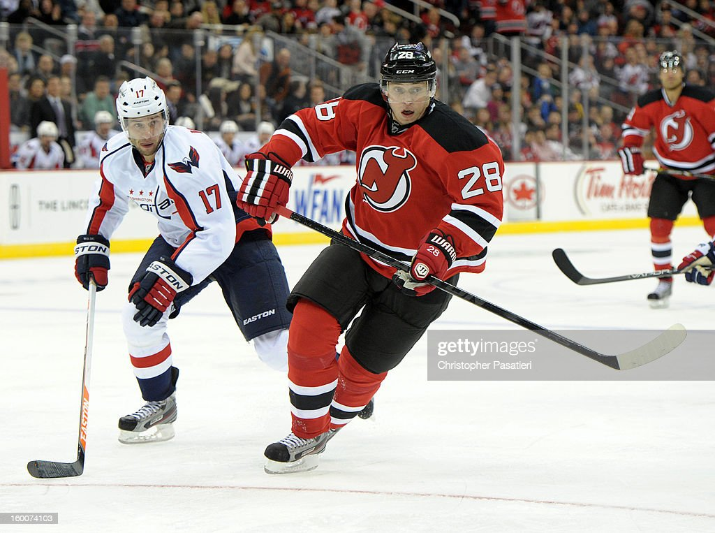 Anton Volchenkov #28 of the New Jersey Devils skates against Wojtek Wolski #17 of the Washington Capitals during the game on January 25, 2013 at the Prudential Center in Newark, New Jersey.