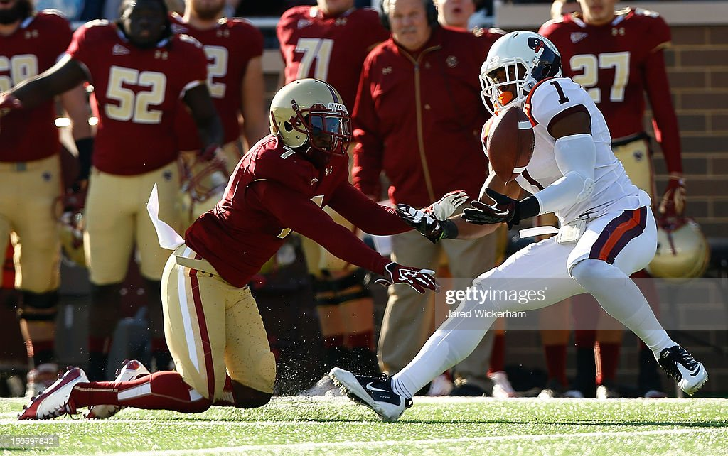 Antone Exum #1 of the Virginia Tech Hokies intercepts a pass in front of Spiffy Evans #7 of the Boston College Eagles during the game on November 17, 2012 at Alumni Stadium in Chestnut Hill, Massachusetts.