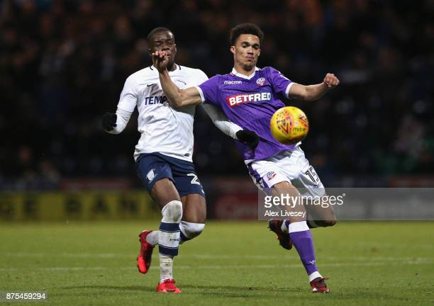 Antonee Robinson of Bolton Wanderers holds off a challenge from Stephy Mavididi of Preston North End during the Sky Bet Championship match between...