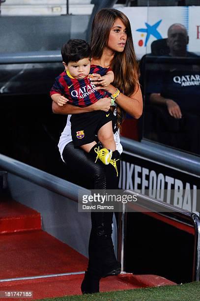 Antonella Roccuzzo and her son Thiago Messi walk onto the pitch prior to the La Liga match between FC Barcelona and Real Sociedad de Futbol at Camp...