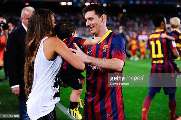 Antonella Roccuzzo and Lionel Messi of FC Barcelona hold their son Thiago Messi prior to the La Liga match between FC Barcelona and Real Sociedad de...