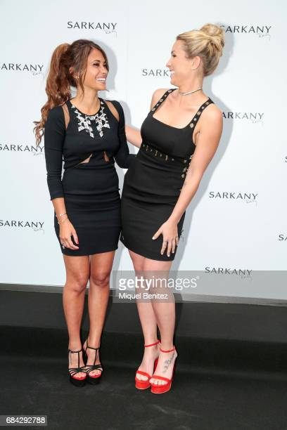 Antonella Roccuzzo and Sofia Balbin pose for a photocall of the Sarkany Shoes Boutique Openeing in Barcelona on May 17 2017 in Barcelona Spain