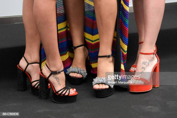 Antonella Roccuzzo Daniella Semaan and Sofia Balbi Sarkany shoe detail attend a photocall for the new Sarkany Boutique opening on May 17 2017 in...