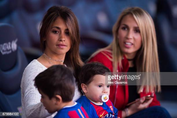 Antonella Roccuzzo girlfriend of Lionel Messi of FC Barcelona pays attention to her sons Thiago Messi and Mateo Messi next to Sofia Balbi wife of...