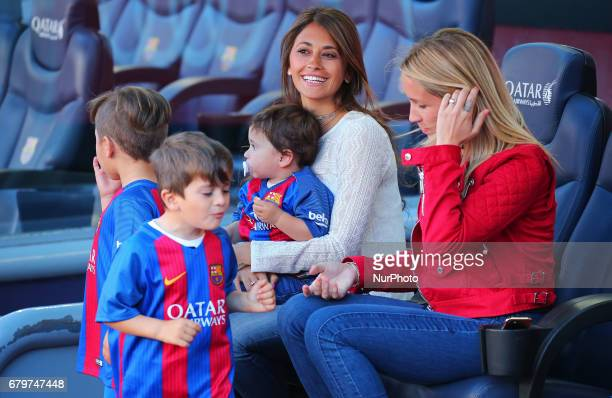 Antonella Roccuzzo the girl friend ofLeo Messi and Sofia Balbi the wife of Luis Suarez and his children during the match between FC Barcelona and...
