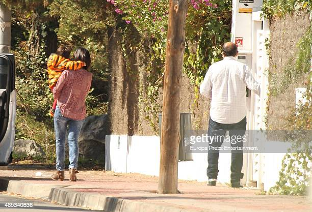 Antonella Roccuzzo's parents Jose Ruben Roccuzzo and Patricia Blanco are seen with their grandson Thiago Messi on March 3 2015 in Barcelona Spain...
