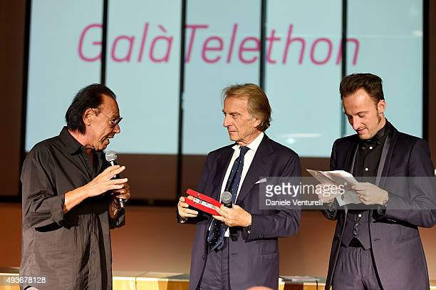 Antonello Venditti is awarded by Luca Cordero di Montezemolo and Francesco Facchinetti on stage during the Telethon Gala during the 10th Rome Film...
