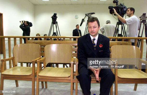 Antoni Adamiak of London sits in Kalamata Court for his appeal after being found guilty of illegally gathering secret information from Greek military...