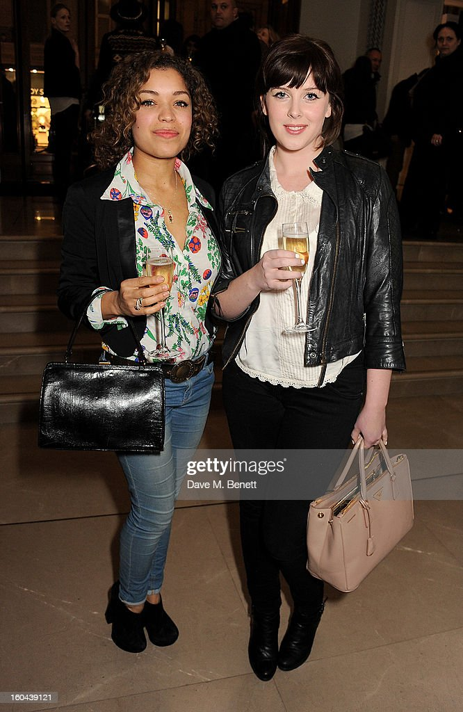 Antonia Thomas (L) and Alexandra Roach attend the Burberry Live at 121 Regent Street event on January 31, 2013 in London, England.