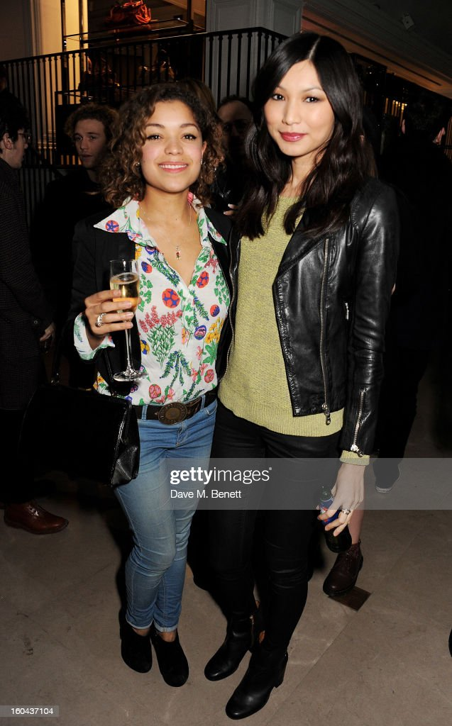 Antonia Thomas (L) and Gemma Chan attend the Burberry Live at 121 Regent Street event on January 31, 2013 in London, England.