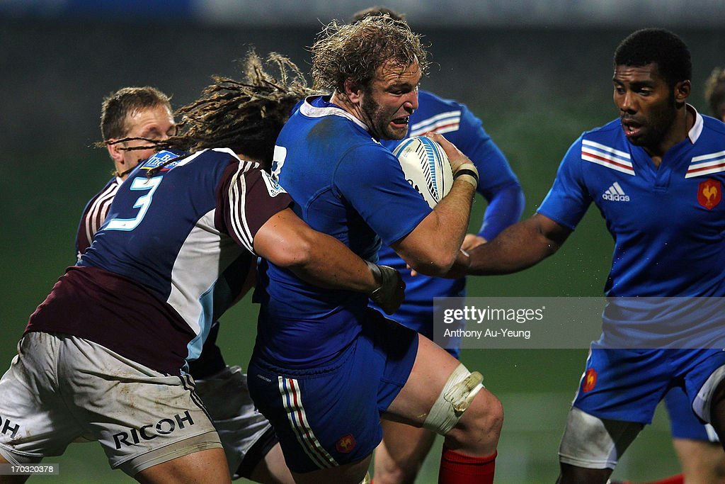Antonie Claassen of France is tackled by Ofa Ofa Tu'ungafasi of the Blues during the tour match between the Auckland Blues and France at North Harbour Stadium on June 11, 2013 in Auckland, New Zealand.