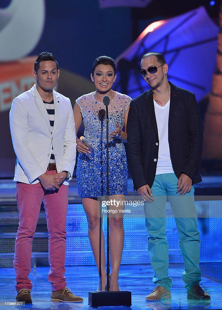 Antonieta Collins (center) speaks onstage with Angel y Khriz during the Premios Juventud 2013 at Bank United Center on July 18, 2013 in Miami, Florida.