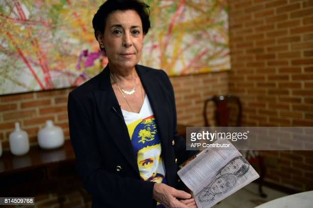 Antonieta Mendoza mother of Venezuelan opposition leader Leopoldo Lopez shows drawings made by her son depicting her and his grandson during an...