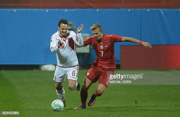 Antonin Barak of Czech Republic vies for a ball with Mike Jensen of Denmark during the friendly football match Czech Republic vs Denmark in Mlada...
