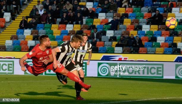 Antonin Barak of Udinese Calcio competes with Leonardo Pavoletti of Cagliari Calcio during the Serie A match between Udinese Calcio and Cagliari...