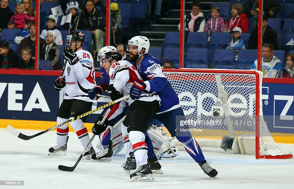 Antonin Manavian (R) of France battles for position with Thomas Vanek (L) of Austria during the IIHF World Championship group H match between France and Austria at Hartwall Areena on May 5, 2013 in Helsinki, Finland.