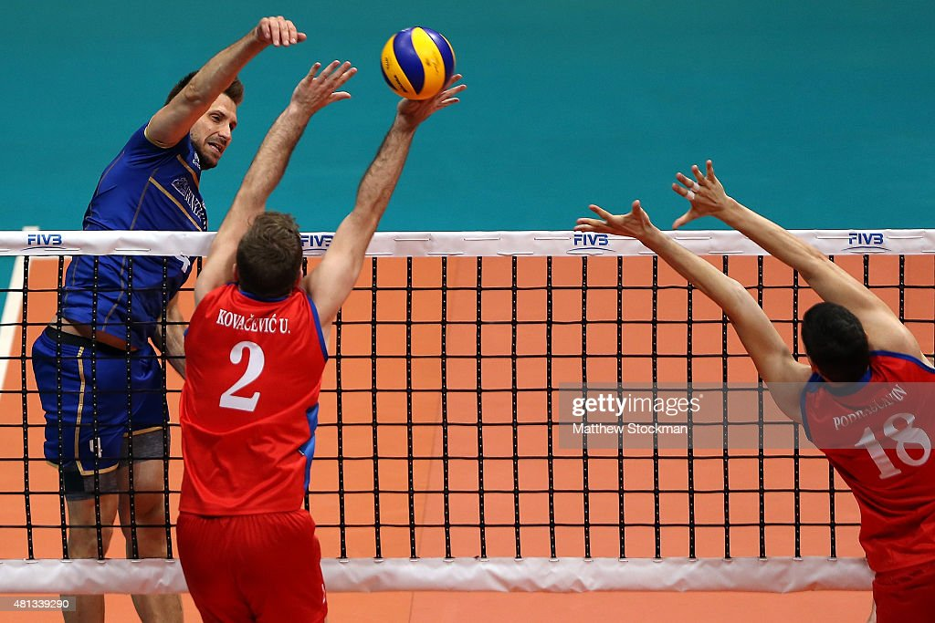 Antonin Rouzier of France spikes the ball against (L-R) Uros Kovacevic and <a gi-track='captionPersonalityLinkClicked' href=/galleries/search?phrase=Marko+Podrascanin&family=editorial&specificpeople=4037691 ng-click='$event.stopPropagation()'>Marko Podrascanin</a> of Serbia during the FIVB World League Group 1 Finals gold medal match between Serbia and France at Maracanazinho on July 19, 2015 in Rio de Janeiro, Brazil.