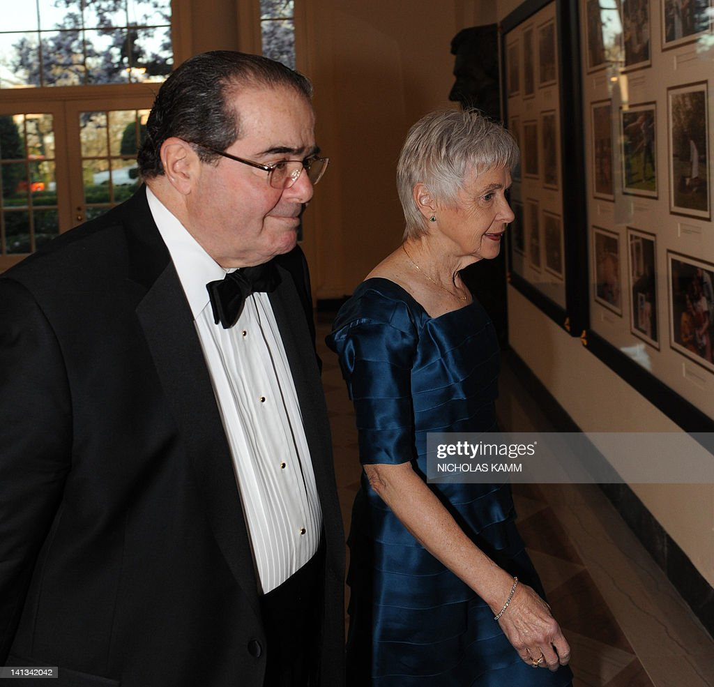 Antonin Scalia, Associate Justice of the United States Supreme Court, and Maureen M. Scalia arrive for the State Dinner in honor of British Prime Minister David Cameron at the White House in Washington on March 14, 2012. Cameron and his wife Samantha are on a three-day official visit to the US. AFP PHOTO/Nicholas KAMM