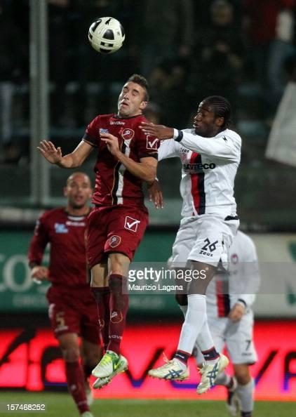 Antonino Barilla' of Reggina competes for the ball n air with Kelvin Matute of Crotone during the Serie B match between Reggina Calcio and FC Crotone...