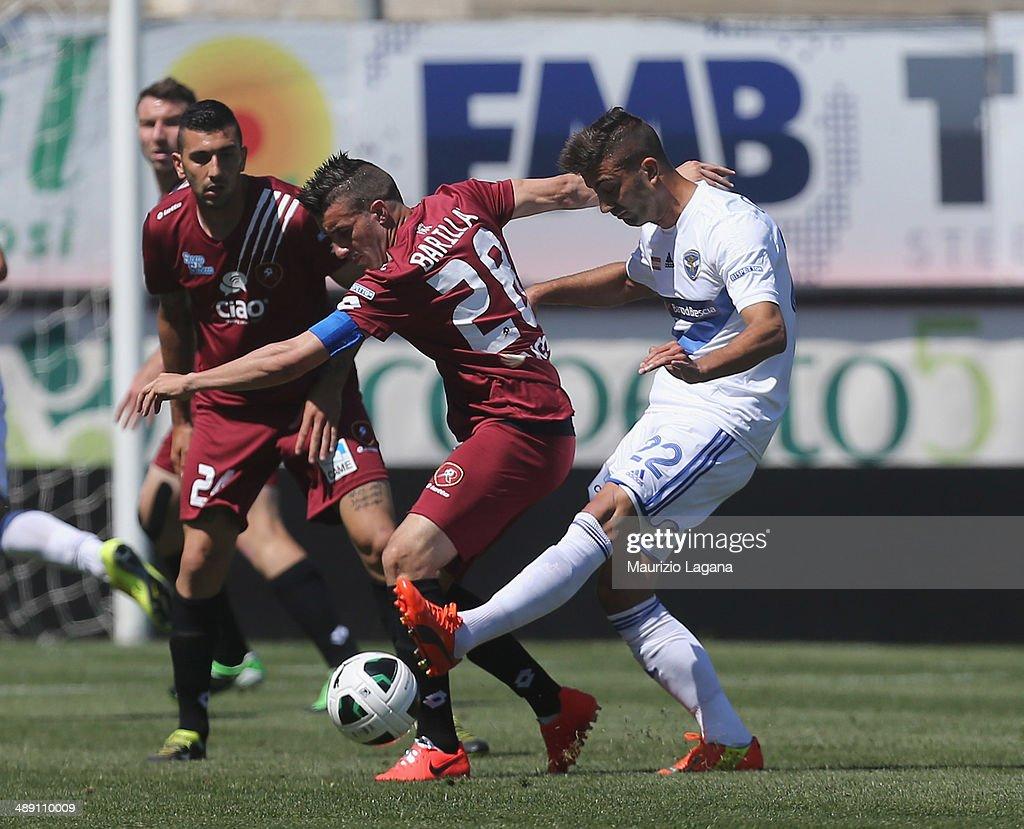 Antonino Barilla' (L) of Reggina competes for the ball with Paolo Grossi of Brescia during the Serie A match between Reggina Calcio and Brescia Calcio on May 10, 2014 in Reggio Calabria, Italy.