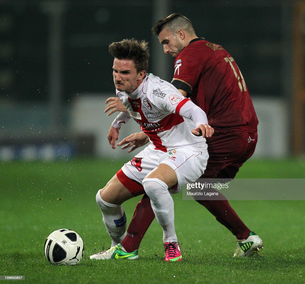 Antonino Barilla' (R) of Reggina competes for the ball with Sebastien Wuthrich of Sion during the friendly match between Reggina Calcio and FC Sion on January 18, 2013 in Reggio Calabria, Italy.